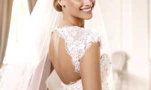 Выбираем кружевное свадебное платье с открытой спиной